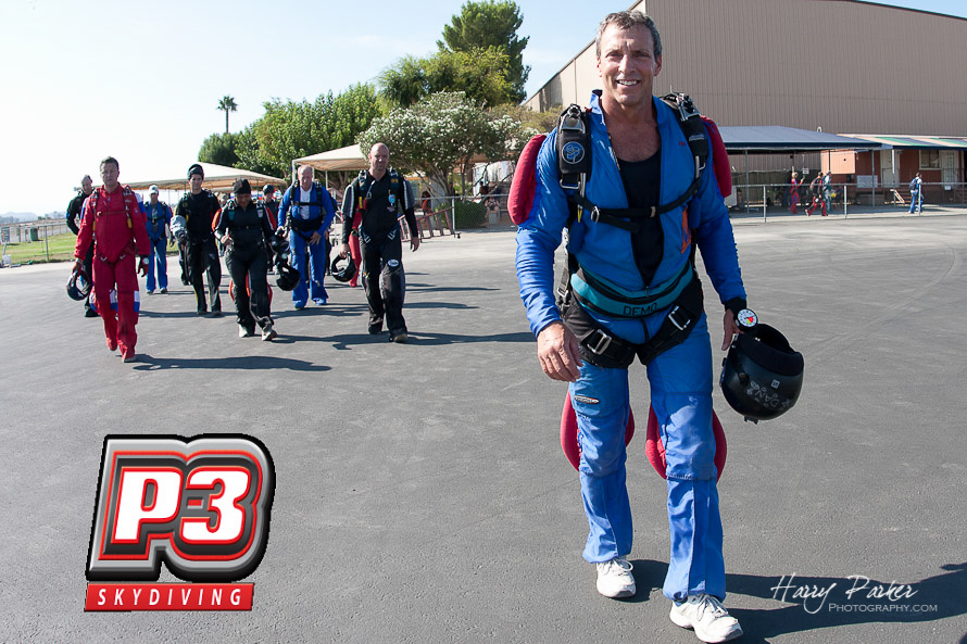 World Champion Danbrodsky Chenfeld walks jumpers to the plane, photo by harry parker