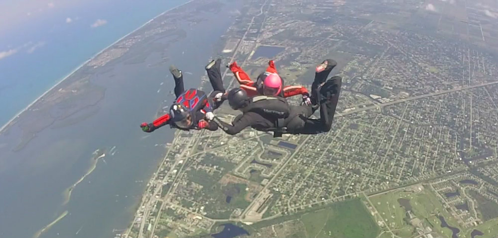 Jump In Sebastian Hosts SIS Event as 3 way women's skydiving formation over Sebastian