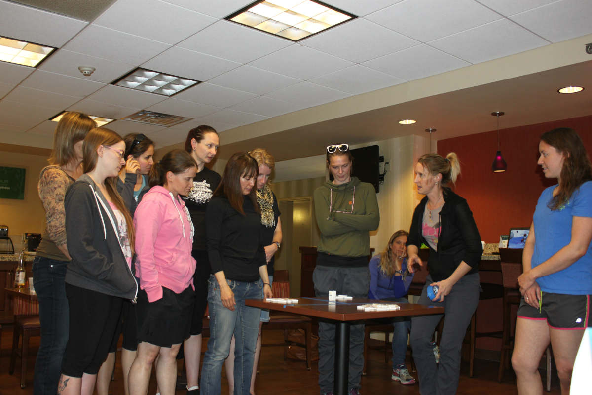 Jen Sharp works with the conference members with a team building exercise using dominos