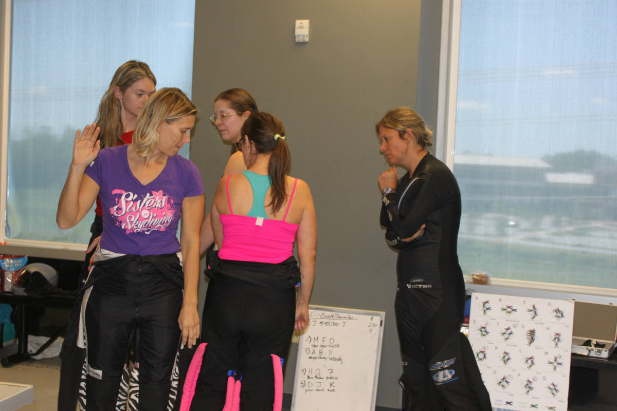 ladies practice 4 way while JaNette coaches position